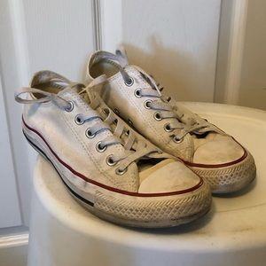 Worn white low top converse size 7
